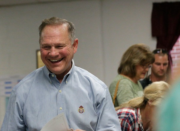Former Alabama Chief Justice and U.S. Senate candidate Roy Moore votes at the Gallant Volunteer Fire Department, during the Alabama Senate race, Tuesday, Sept. 26, 2017, in Gallant, Ala. (AP Photo/Brynn Anderson)