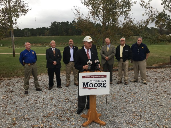 Former Alabama Supreme Court Chief Justice Roy Moore appears with some of the sheriffs who endorsed him today in Montgomery.