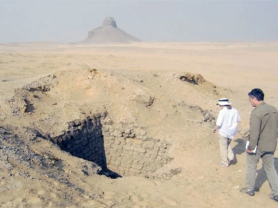 Dr. Sarah Parcak, left, examines an Egyptian burial site with a colleague. Parcak co-led an expedition that discovered more than 800 tombs in Lisht, an ancient burial site in southern Egypt. (University of Alabama at Birmingham)