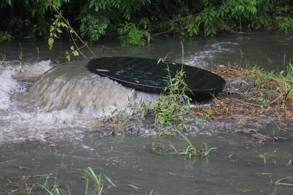 A sanitary sewer near the intersection of Navco Rd and McVay Drive in Mobile overflows on August 16, 2016.