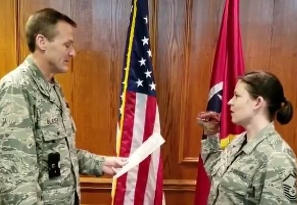 Three members of the Tennessee Air National Guard were removed from their posts after a video of one taking her oath using a dinosaur puppet went viral. (Facebook screen grab)