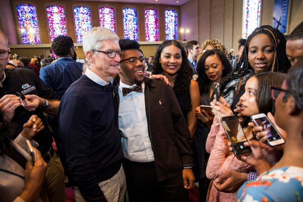 Alabama native and Apple CEO Tim Cook pauses for selfies with young fans after a symposium at Sixth Avenue Baptist Church in Birmingham on April 4, 2018.