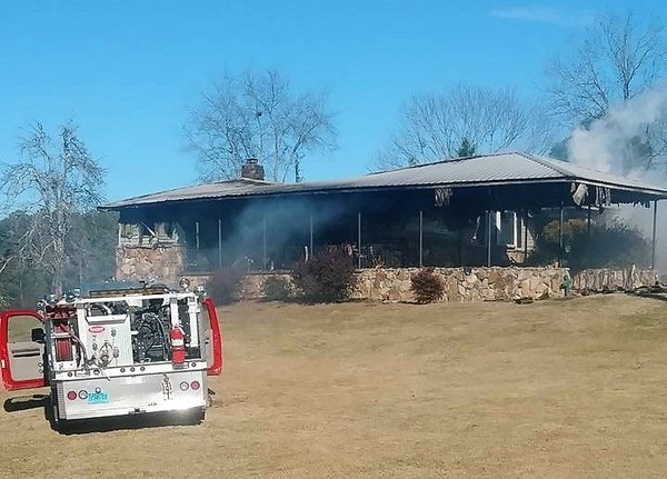 """Tina Johnson's home on Lake Mary Louise Road in Gadsden burned on Jan. 2, 2018. The Etowah County Arson Task Force is investigating, and the sheriff's department has spoken with a """"suspect of interest."""" (Submitted)"""