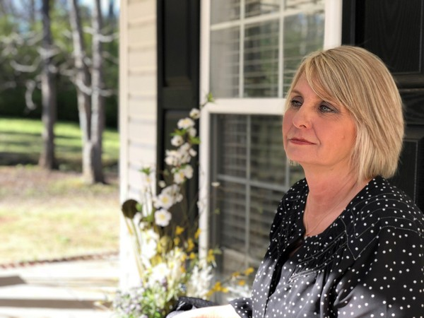 Tina Johnson, one of Roy Moore's accusers, is pictured at her new home in March 2018, purchased in part with money donated through GoFundMe.com after her home was destroyed by fire in January. cause of the fire that destroyed Johnson's home has been ruled 'undetermined' by the Gadsden Fire Department. (Anna Claire Vollers | avollers@AL.com)