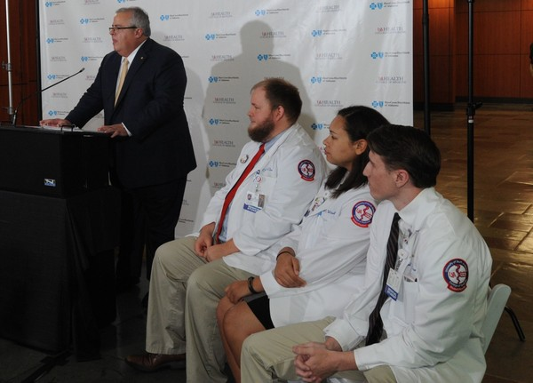 Three medical students at the USA College of Medicine will be the school's first to take part in a scholarship program funded by Blue Cross Blue Shield of Alabama. Kyle Clark, Perrin Windham and Michael Marfice, from left, listen as Dr. John Marymont, vice president for medical affairs and dean of the college of medicine at USA, speaks about the program's intended benefits. (Lawrence Specker/LSpecker@AL.com)