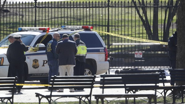 """Law enforcement officers gather in front of the White House in Washington, after the area was closed to pedestrian traffic, Saturday, March 3, 2018. Authorities said a man shot himself to death outside the White House midday. The District of Columbia Police Department says in a tweet that """"adult make has been declared deceased. We are working to notify next of kin."""" (AP Photo/Pablo Martinez Monsivais)"""