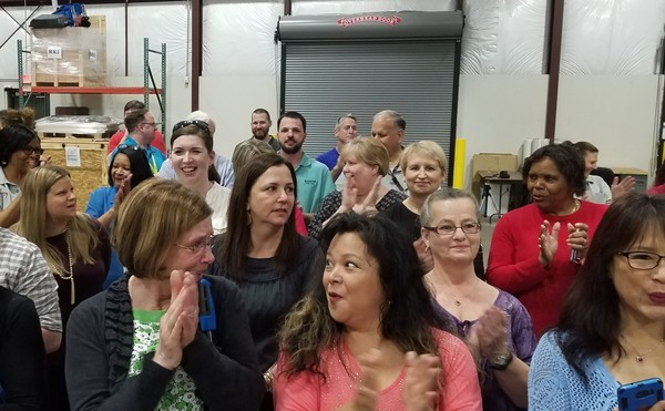 Employees of Xante Corp. react to the announcement on Monday that they were about to receive bonus checks for $1,200. Xante CEO Robert Ross made the announcement the morning of Feb. 19, 2018, attributing the move to recent tax cuts. (Lawrence Specker/LSpecker@AL.com)