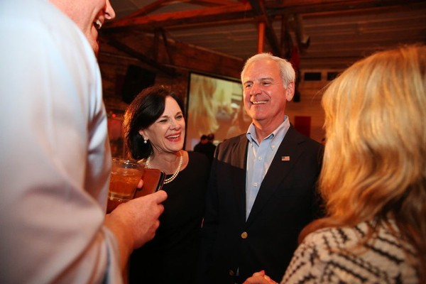 U.S. Representative Bradley Byrne from Alabama's 1st Congressional District and his wife Rebecca Byrne talk to supporters after he was declared the winner of his congressional seat at his election party at Moe's Original BBQ in Mobile, Ala., on March 1, 2016. From left are his wife Rebecca Byrne, daughter Laura Byrne, his son Patrick Byrne holding grandson MacGuire Byrne, and daughter-in-law Carolyn Byrne. Byrne is seeking re-election to the seat during the November 2018 general election. If he wins, Byrne could consider running against Democrat Doug Jones in the 2020 U.S. Senate election. (file photo)