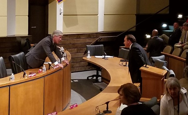 Before the start of Tuesday's Mobile City Council meeting, Councilman Joel Daves, left, speaks to Nick Lawkis, associate director of governmental relations for the University of South Alabama. (Lawrence Specker/LSpecker@AL.com)