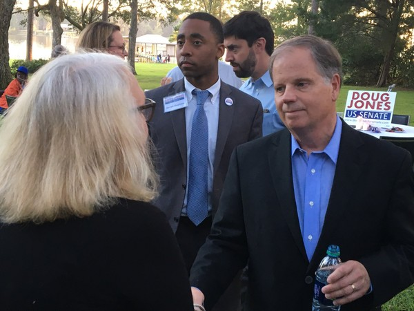 Doug Jones, the Democratic candidate for U.S. Senate, talks with supporters during a campaign rally on Wednesday, Oct. 18, 2017, outside a rural Mobile, Ala., home along Dog River. (John Sharp/jsharp@al.com).