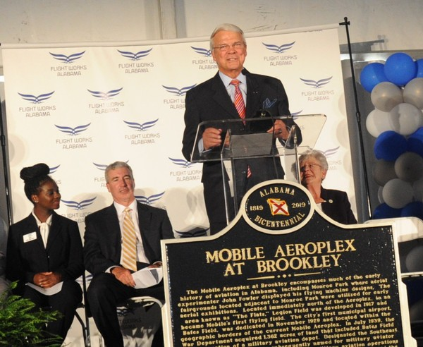Alan McArtor, chairman emeritus of Airbus Americas, speaks about plans for Flight Works Alabama, a new educational facility to be built at the Mobile Aeroplex at Brookley. Behind him are, from left: Baker High School student Asia Haith, Airbus Americas Chairman and CEO Jeff Knittel and Gov. Kay Ivey. The groundbreaking ceremony for Flight Works took place on Wednesday, Sept. 12, 2018. (Lawrence Specker/LSpecker@AL.com)