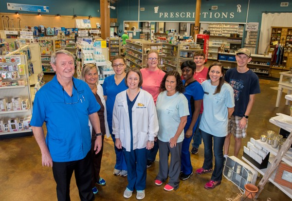 McConaghy Drugs owner Dan McConaghy, left, is seen with his staff in Satsuma, Ala.