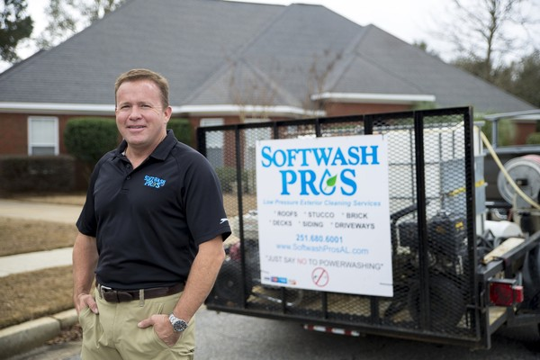 Doug Houston, owner of Softwash Pros, is seen outside a customer's home in Daphne. (Michael Dumas/AL.com Correspondent