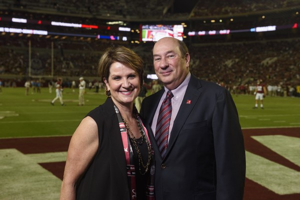 Marillyn and James Hewson on the field at Bryant-Denny Stadium at The University of Alabama.