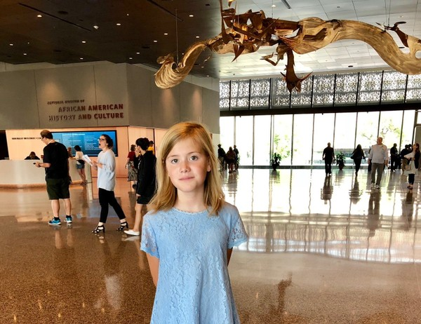 """Lily Hoyle, 12, at the National Museum of African American History and Culture, before the screening of her documentary, """"The Lynching That Brought Down the Klan in Alabama."""""""