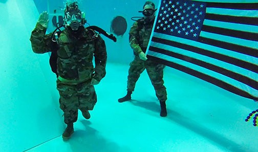 U.S. Army Staff Sgt. Michael Brown reenlists 30 feet underwater at the U.S. Space & Rocket Center, Huntsville, Alabama, Aug. 31. Brown, a U.S. Army Space and Missile Defense Command/Army Forces Strategic Command Soldier, combat veteran and Wounded Warrior was introduced to scuba diving as a part of adaptive rehabilitation following the loss of his left leg in 2007 during combat operations in Iraq.
