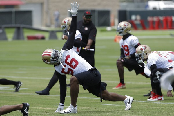 San Francisco 49ers linebacker Reuben Foster stretches during practice at the NFL team's training facility in Santa Clara, Calif., on May 30, 2018.