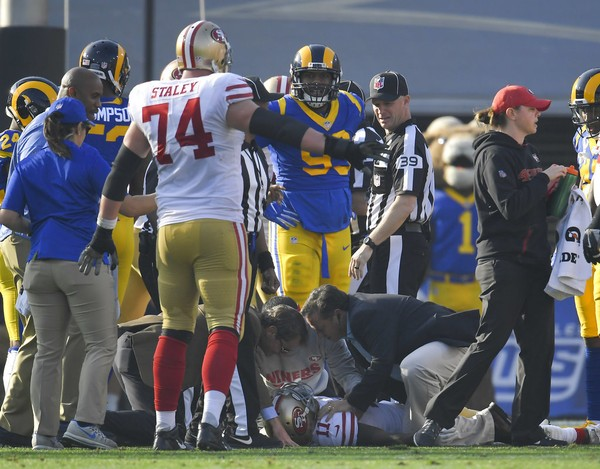 5306bcac5f3 San Francisco 49ers wide receiver Marquise Goodwin is tended to on the turf  after being injured