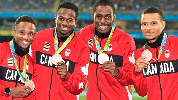 Akeem Haynes (left) poses with his teammates on Canada's 400-meter relay team as they show off their bronze medals at the 2016 Summer Olympic Games in Rio Janeiro.
