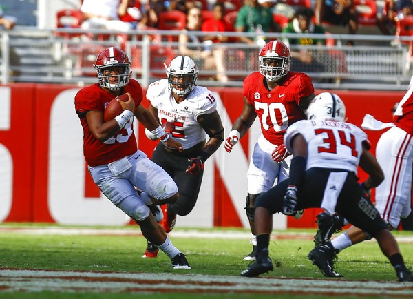 Alabama quarterback Tua Tagovailoa (13) scrambles for a first down during the second half of an NCAA college football game against Arkansas State, Saturday, Sept. 8, 2018, in Tuscaloosa, Ala. Alabama won 57-7. (AP Photo/Butch Dill)