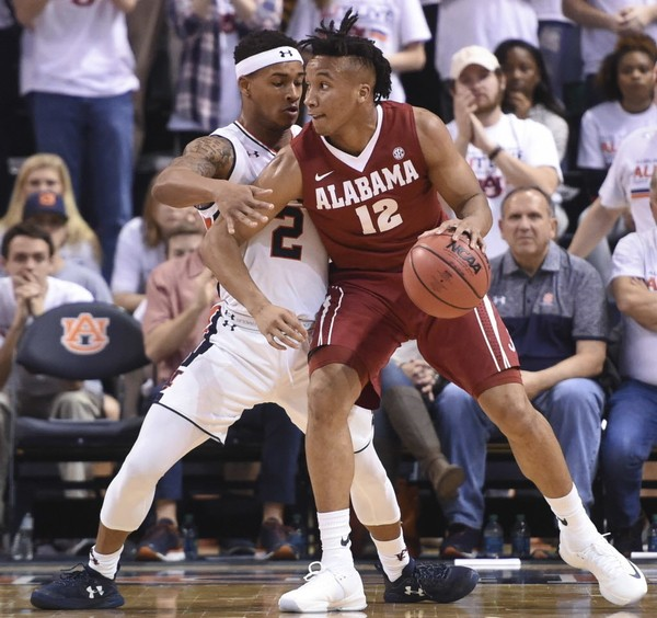 Alabama was picked fourth and Auburn ninth in preseason SEC basketball poll.