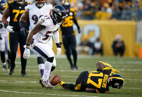 Baltimore Ravens middle linebacker C.J. Mosley breaks up a pass to Pittsburgh Steelers wide receiver Eli Rogers during an NFL game on Dec. 25, 2016, in Pittsburgh.