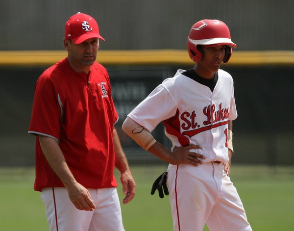 Former St. Luke's coach Tim Becker, left, made the decision to put Jeremiah Jackson in at shortstop in the seventh grade. He played for the Wildcats for the next six years. (Scott Donaldson | preps@al.com)