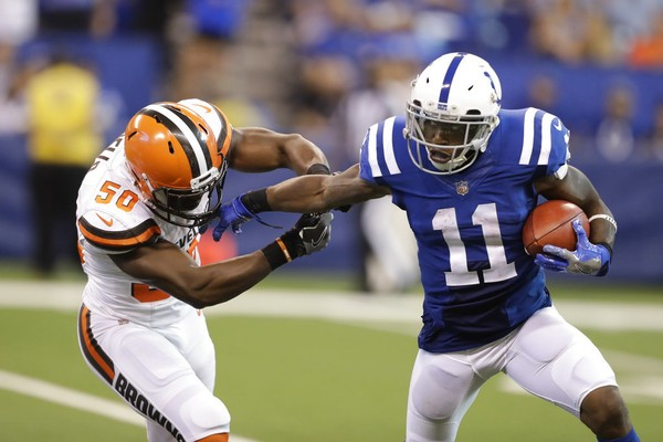 Indianapolis Colts wide receiver Quan Bray holds off Cleveland Browns linebacker B.J. Bello on a punt return during an NFL game in Indianapolis on Sept. 24, 2017.