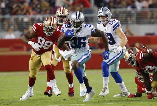 Dallas Cowboys running back Bo Scarbrough carries the football during an NFL preseason game against the San Francisco 49ers on Aug. 9, 2018.