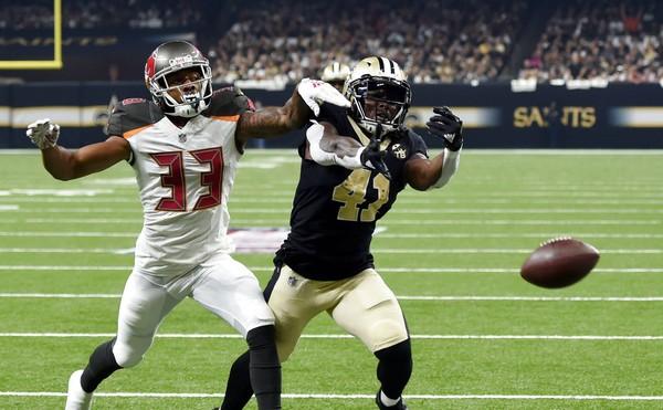 Tampa Bay Buccaneers cornerback Carlton Davis (33) defends against New Orleans Saints running back Alvin Kamara during an NFL game on Sunday, Sept. 9, 2018, in New Orleans.