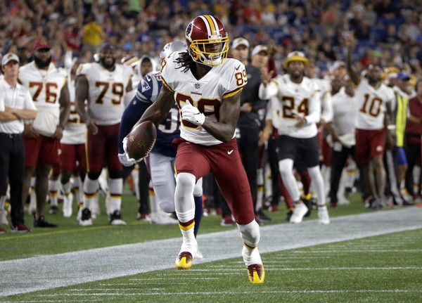 Washington Redskins wide receiver Cam Sims runs after catching a pass an NFL  preseason game against ea1e9f9e0