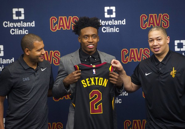e34a1db49e69 Cleveland Cavaliers first-round draft choice Collin Sexton (center)  displays his jersey with