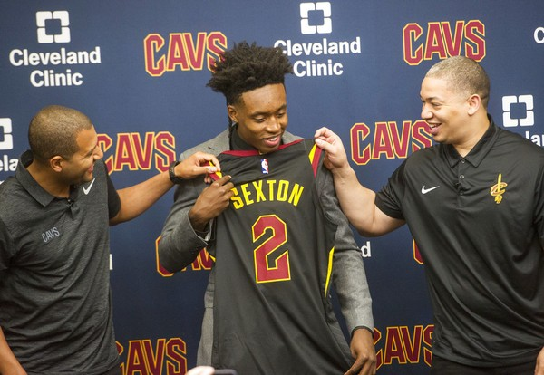 Cleveland Cavaliers first-round draft selection Collin Sexton (center)  checks out his new 0eddceafb