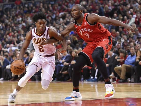 700b11fbf0b2 Cleveland Cavaliers guard Collin Sexton drives past Toronto Raptors forward  Serge Ibaka during an NBA game