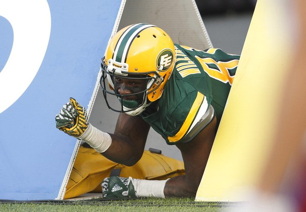"Edmonton Eskimos wide receiver D'haquille ""Duke"" Williams crawls out of an advertising placard during a touchdown celebration in a CFL game against the Montreal Alouettes on Saturday, Aug. 18, 2018."