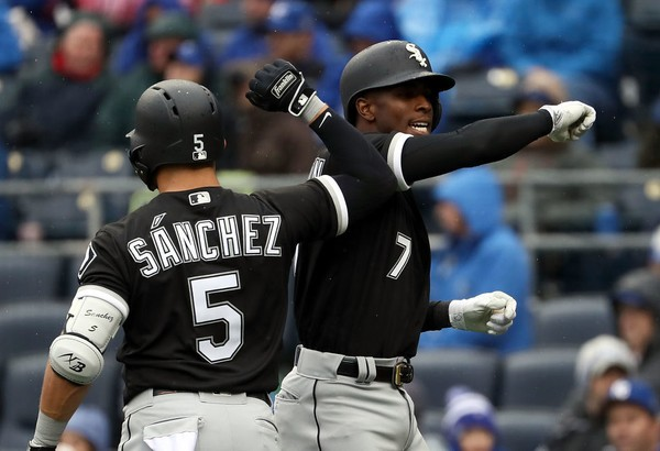 Chicago White Sox shortstop Tim Anderson (7) celebrates with teammate Yolmer Sanchez after hitting a home run during an American League game against the Kansas City Royals on Thursday, March 29, 2018, in Kansas City, Mo.