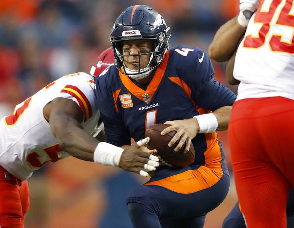 Kansas City Chiefs outside linebacker Dee Ford sacks Denver Broncos quarterback Case Keenum during an NFL game on Monday, Oct. 1, 2018, in Denver.