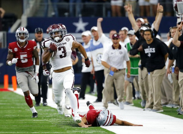Texas A&M wide receiver Christian Kirk returns a kickoff for a touchdown during an SEC game against Arkansas on Sept. 23, 2017, in Arlington, Texas.