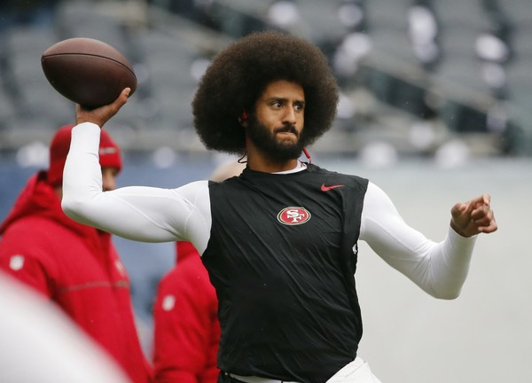 "San Francisco 49ers quarterback Colin Kaepernick warms up before an NFL football game against the Chicago Bears. Spike Lee said on Instagram Sunday, March 19, 2017, that it was ""fishy"" that Kaepernick, now a free agent, hadn't been signed."""