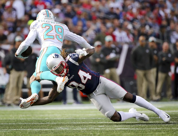 Miami Dolphins defensive back Minkah Fitzpatrick runs with the football after making an interception during an NFL game against the New England Patriots on Sunday, Sept. 30, 2018, at Gillette Stadium in Foxborough, Mass.