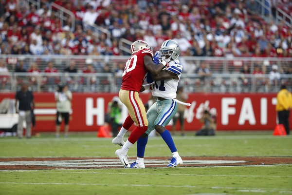 San Francisco 49ers defensive back Jimmie Ward and Dallas Cowboys wide receiver Allen Hurns battle for the football during an NFL preseason game on Thursday, Aug. 9, 2018, in Santa Clara, Calif.