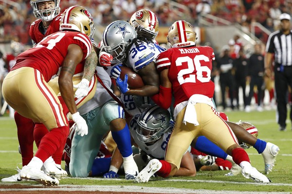 Dallas Cowboys running back Bo Scarbrough wedges into the end zone during an NFL preseason game against the San Francisco 49ers on Thursday, Aug. 9, 2018, in Santa Clara, Calif.