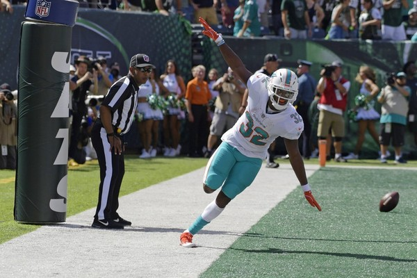 Miami Dolphins running back Kenyan Drake celebrates after scoring a touchdown during an NFL game against the New York Jets on Sunday, Sept. 16, 2018, in East Rutherford, N.J.