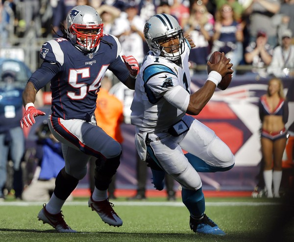 Carolina Panthers quarterback Cam Newton tries to get away from New England Patriots linebacker Dont'a Hightower during an NFL game on Oct. 1, 2017, in Foxborough, Mass.