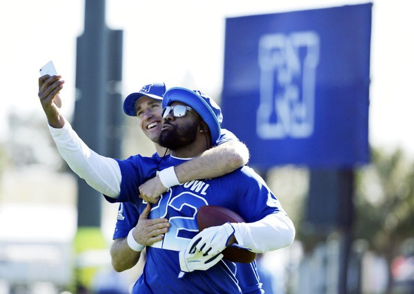 NFC quarterback Drew Brees (back) and running back Mark Ingram of the New Orleans Saints take a selfie during Pro Bowl practice on Wednesday, Jan. 24, 2018, in Kissimmee, Fla.