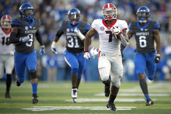 FILE - In this Saturday, Nov. 3, 2018, file photo, Georgia running back D'Andre Swift (7) runs for a touchdown during the second half an NCAA college football game against Kentucky in Lexington, Ky. (AP Photo/Bryan Woolston, File)