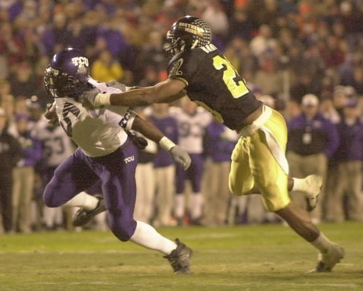 Southern Miss defensive back Leo Barnes tackles TCU running back LaDainian Tomlinson during the GMAC Mobile Alabama Bowl on Dec. 20, 2000, at Ladd-Peebles Stadium.