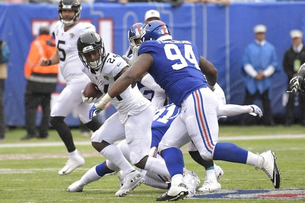 Jacksonville Jaguars running back T.J. Yeldon tries to get past New York Giants defensive lineman Dalvin Tomlinson during an NFL game on Sunday, Sept. 9, 2018, in East Rutherford, N.J.
