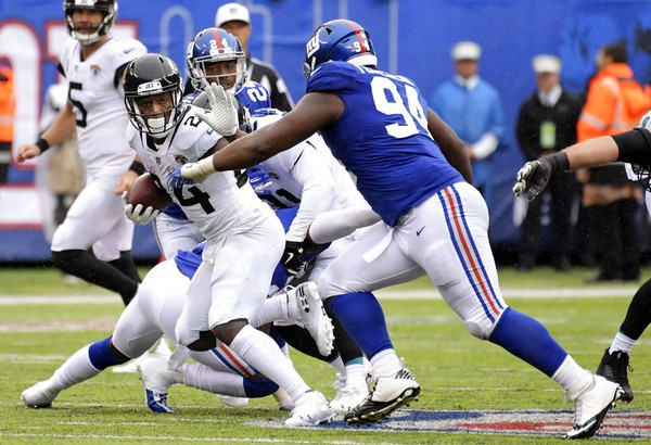 Jacksonville Jaguars running back T.J. Yeldon tries to get past New York Giants defensive tackle Dalvin Tomlinson during an NFL game on Sunday, Sept. 9, 2018, at MetLife Stadium in East Rutherford, N.J.