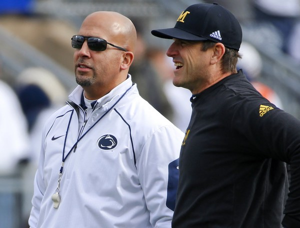 Michigan head coach Jim Harbaugh, right visits with Penn State head coach James Franklin before an NCAA college football game in State College, Pa., Saturday, Nov. 21, 2015. This week Franklin awarded long snapper Kyle Vasey a scholarship. (AP Photo/Gene J. Puskar)